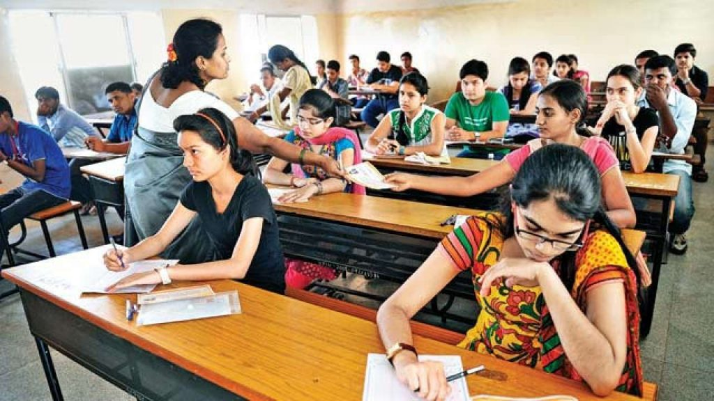 Indian Students who wish to study MBBS must attend NEET exam. Students in NEET exam hall